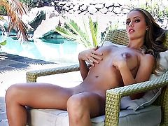 Nicole Aniston with massive knockers and smooth muff takes toy up her cunt after sexy striptease