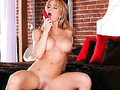Angela Sommers with big hooters and trimmed twat has fire in her eyes as she bangs herself with sex toy