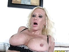 Blonde with juicy knockers takes dream cumshot on her face