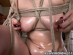 Asian floozy who loves the freaky bdsm exploits has a hanging experience and she is finger fucked by the domina. She has a nice pink pussy and a hot domination bdsm session.