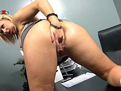 The blonde and the black haired make love inside A office