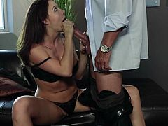 Brunette babe Chanel Preston in black lingerie gives blowjob to a horny guy with legs apart. She hides her juicy boobs under her bra and plays with her twat with her panties on.