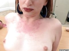 Redhead is handling a dick