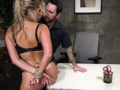 Tommy treats slutty Savana like a filthy slave, pushing her to take his cock down her throat, as she waits obediently on knees. Hands tied up backsides, this blonde bitch with tattoos is about to get pounded hard, the way she'll savor the lingering remains of a rough, but unforgettable experience...