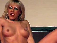 busty blonde flexible milf masturbating on public sex show stage