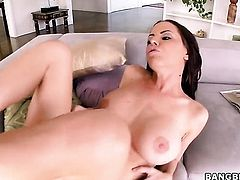 Naked Brandy Aniston with huge tits gives handjob