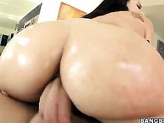 Huge ass lady puts some oil on herself