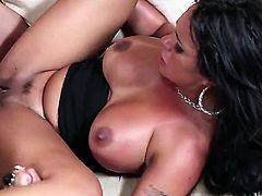 Brunette cougar is in front of a dude, doing it doggy style. Her huge tits are moving back and forth as she is getting penetrated. She is moaning loudly in this video.
