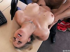 Julia Ann with juicy knockers gives giving oral pleasure to horny dude Johnny Sins