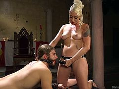 Lorelei decides to do a little role reversal tonight. It's her man that is bound, gagged and bent over. She has a black strap on. She tells him to suck it, even though he's gagged. She gets behind him and stuffs that rubber dick right in his asshole, showing no mercy, as she thrusts deep and hard.