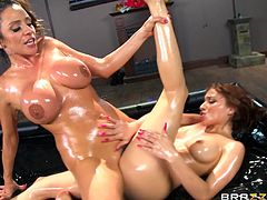 Ariella and her sexy girlfriend Adessa are oiled up and rubbing each other sensually. They slide all over each other in the most erotic way. Watch as they kiss passionately and eat their hot cunts out. The Colombian goddess uses her feet to foot fuck her lover's twat.