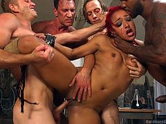 Daisy is always into kinky stuff, especially any kind of bondage. She has her hands restrained and attached to cables, which keep her where she is, at the mercy of this foursome of horny men. Her pussy and her mouth get stuffed with dick, even taking two in her mouth at once. Daisy is a hardcore star!
