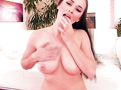 Taylor Vixen with juicy jugs and smooth muff gives a closeup view of her pussy as she masturbates