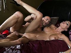 Jessica Jaymes with huge melons finds herself getting fucked by Johnny Sins