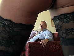 Tattooed Klarisa Leone in black stockings in sexy corset flaunts her assets in front of lucky men and then play with their stiff cocks. This flirty slut is good at cock stroking.