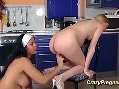 two cute lesbian extreme preggo teens kissing and licking