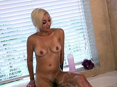 Ivy doesn't know that her boyfriend's friend is filming her, while she takes a bath and rubs herself, but when she discovers this, she doesn't react the way most would. It actually turns her on a little bit, and she moves to the bedroom for some more playful fun. He even gets his fingers in there.