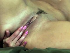 Anna Morna with small tits and shaved bush gets the pleasure from pussy fingering like never before