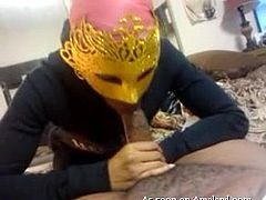 This guy is getting a blowjob from his girlfriend, which is awesome no matter how and where it happens. She's a little kinky though, or just doesn't want to be seen on camera, because she stays concealed the whole time. She wears a mask like you'd see in a Mardi Gras parade or a masquerade.