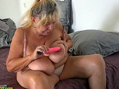 Hedwig may be old and chubby, but she's got some huge tits! She sucks on a dildo between her melons and fucks herself with it, before her much younger partner joins in, a black strap-on underneath her skirt. The old whore sucks on it with great pleasure, as she continues to masturbate. She needs more.