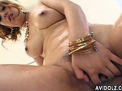 Sucking two dicks at once is a great fun of oiled busty Japanese lady