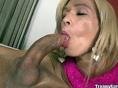Yago's juicy cock makes this blonde tranny drip precum from her she-cock. She can't wait to wrap her lips around it and give an amazing blowjob. He is a caring lover, so he jerks her off while he's inside her ass. Watch as she's fucked so hard from behind. She needs more cock and goes ass to mouth.