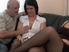 Two sexy babes with big tits share an old cock