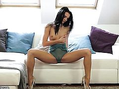 Brunette Sapphira is on the way to the height of pleasure in solo scene