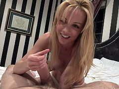 Busty long haired babe Kayden Kross in beautiful lingerie gives handjob to a lucky man from your point of view. She strokes his dick with smile on her face. Watch big breasted girl jerk him off.
