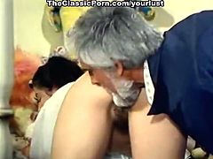Classy chick with jet black hair gives her lover a great blowjob in the pool