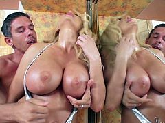Blonde bombshell Summer Brielle plays with her huge tits in front of the camera. Lovely woman cant keep her hands off her oiled up boobs. Busty Summer Brielle is dangerously sexy.