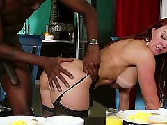 Janet Mason is a hot milf with some large fake tits. The redhead is with a black dude. He is her stepson. He loves sticking his large cock inside her.