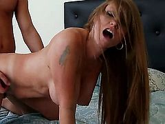 Darla Crane is a hot brunette that is flashing her large tits to the guy that has picked her up in the bar. She is about to have a good night in the sack with the man.