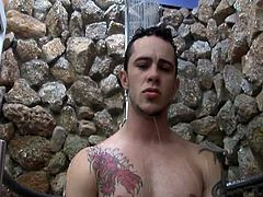 Arcanjo is out by the swimming area, taking a shower now that he's finished. He starts jerking off, wishing and fantasizing about a strong black man with a big dick to suck on, and get fucked by. His wish comes true in the form of Renzo, a very studly man indeed. He takes over the hand work Arcanjo.