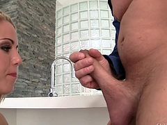 Blonde babe Christen Courtney with sexy ass gets down on her knees in the bathroom to play with David Perry meat pole. She licks his dick and then her grabs her ass cheeks.