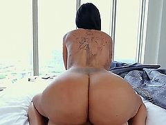 Lela Star is a porn star with a huge ass. She is displaying her booty in a pov video. The guy is staring into it as she is riding him like a reverse cowgirl.