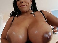 Latina is placing oil on her huge tits. That makes them slippery and a large cock is sliding between them. She is cumshot on her chest and she really loves that.