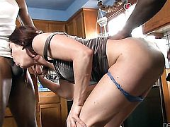 Cici Rhodes opens her mouth invitingly in cock sucking action with Wesley Pipes before backdoor sex