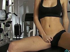Slender leggy blondie masturbates her surely hungry cunt in the gym