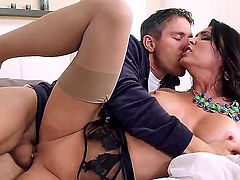Jessica Jaymes is a milf with huge tits. She is with a mobster and she is doing her duties as a mob wife. She just got some treats and now she is riding a dick.