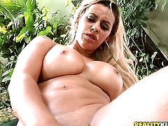Blonde Nicolle Bitencourt with gigantic hooters and bald muff touches her eager bum as she has anal fun alone on cam