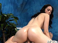 Beauty gets oiled and rides big cock with excitement