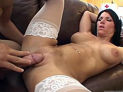 Super hot nurse in white stockings is showing off her sex skills