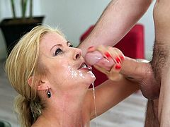 This blonde slut loves sucking dick. She takes it deep into her throat, as he pulls her hair. She loves the taste of his cock and enjoys it. Watch as she sucks his balls, then swallows the length of his pole, as saliva glistens on her face.