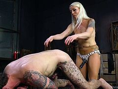 Lorelei will be the one doing the fucking this day. Ryan's cock is of no use right now, as she gets a strap on ready. Oh yeah, she's literally doing the fucking today. She jams that strap on right in his ass, and she gets it all in him. Fantasies of getting dominated by a woman come true right here.