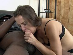 Big black cocks are the only thing on this amateur brunette's mind all the time. She gets on her knees and gives this lucky guy an amazing blowjob, making him cum all over her natural tits.