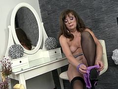 I persuaded my friend's mom Mrs. Yalena, to pose in her boudoir for my photo-set, but looks like she wanted to impress me and continued to a totally nude style. Not every day perfect hot busty mom of your friend exposing her body and masturbates using a dildo. We gonna have one more set.