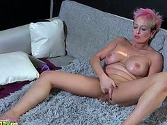 Older mature and sexy girl are playing with each other using toys and fisting