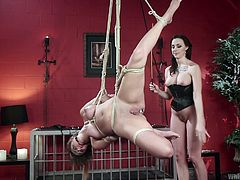 Busty Chanel is a dominant lesbian, who detains a whole arsenal of kinky sex toys. While helpless Charlotte is tied up strongly with ropes, the naughty brunette milf whips her cunt, then begins to use a big dildo. The naked bitch also wears a ball gag, so her screams of both pain and pleasure cannot be heard.