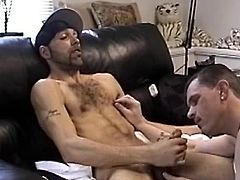 Enrique stands in front of the TV watching porn and jerking off. Vinnie kneels in front of him and starts sucking his cock, but Enrique wants to fuck something. After 5 minutes he has the head of his black dick in Vinnies tight white ass. Then Vinnie sits on his cock, grinds his hips around and he shoots on his stomach. Then he starts sucking Enriques cock again and he shoots on Vinnies lips.